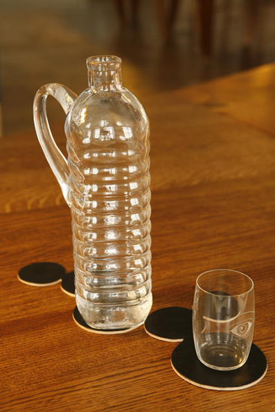 Aqua Minerale 2008 Mouth-blown glass. By designing the glass jug in a generic water bottle shape, a normally disposable object becomes non-disposable.